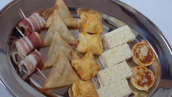 Charcuteries assorties en chiffonnade (Jambon Serrano, Jambon Blanc, Poulet aux herbes, Chorizo, saucisson sec TRAITEUR NANTERRE